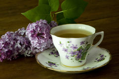 Spring Tea Cup and Lilacs Royalty Free Stock Image