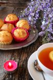 Spring tea: lemon muffins, tea and flowering blue wisteria. Focus selective Royalty Free Stock Photography