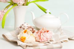 Spring tea set with multicolored fruit fluffy meringue stock photo