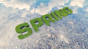 Spring text made from fresh grass among a water stream 4 Stock Image