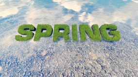 Spring text made from fresh grass among a water stream 1 Royalty Free Stock Photos