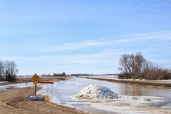 Spring thaw over a road Stock Image