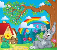 Spring theme with bunny and rainbow Royalty Free Stock Photo