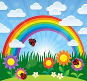 Spring theme with flowers and rainbow Stock Images