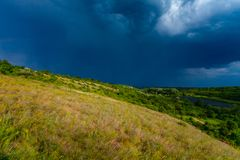 Spring thunderstorm in countryside. Dark blue cloudscape. Environmental landscape in spring royalty free stock images