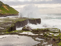 Spring tide and breaking waves at Reunion Rocks, Isipingo, Durban, South Africa Stock Photography