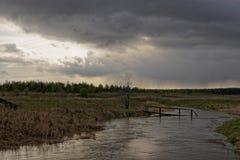 Spring tide. A flooded bridge Stock Photos