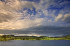 Spring time. Countryside, lake and clouds after rain royalty free stock images