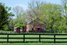 Spring time barn and horse paddock Stock Image