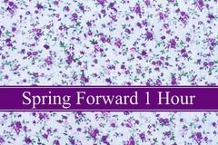 Spring Time Change. Purple flowers fabric and text Spring Forward 1 Hour stock photos