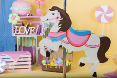 Spring time decor. Spring time cute and bright decor and a horse merry-go-round stock photo