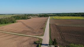 Spring time landscape with gravel road, aerial view stock footage