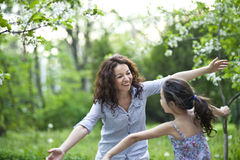 Spring time. Mother and daughter in the spring garden stock photo