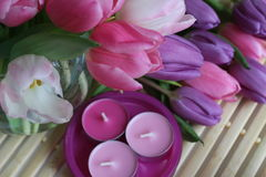 Spring time, Mothers day, flowers and candles, pink, purple, lovely time, nice smell, lovely colors, romantic colors, valentines Royalty Free Stock Photo