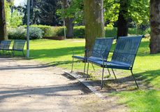 Spring time in park with blue bench Stock Photography