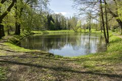 Public gardens in Chotebor with pond during spring season, romantic scene, water reflections Stock Images