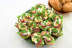 Spring time sandwiches. Top view on sandwiches' plate with breadroll next to it Royalty Free Stock Image