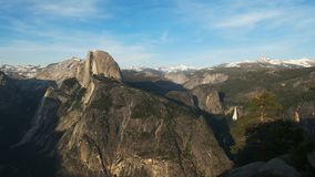 Spring time shot of half dome and Nevada falls from glacier point in Yosemite. National Park stock video