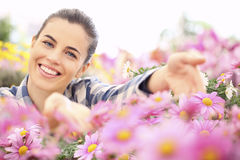 Spring time, smiling woman in the garden of daisies flowers Royalty Free Stock Photo