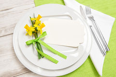 Spring time table decoration daffodils flowers Royalty Free Stock Images