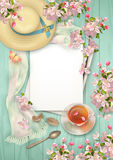 Spring Top View Background. Spring top view wooden background with blank sheets of paper, a straw hat, blossoming tree branches, feathers, glass teacup and Royalty Free Stock Photography