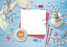 Spring Top View Background. Spring top view wooden background with a cappuccino, brushes, blank sheet of paper and pussy willow branches Stock Photos