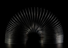 Spring toy slinky on black Stock Images