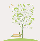 Spring tree. With bench bird and cat Stock Images