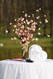 Spring tree in blossom branches in vase at wedding ceremony Royalty Free Stock Photography