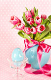 Spring tulip flowers with ceramic easter egg Royalty Free Stock Photos