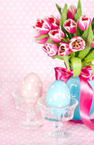 Spring tulip flowers with ceramic easter eggs Stock Images