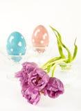 Spring tulip flowers with ceramic eggs Stock Photos