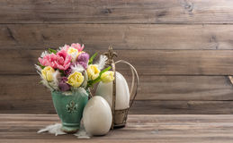 Spring tulip flowers and vintage easter eggs decoration Royalty Free Stock Image