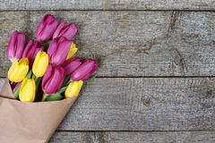Spring tulips bouquet in wrapping paper Royalty Free Stock Images