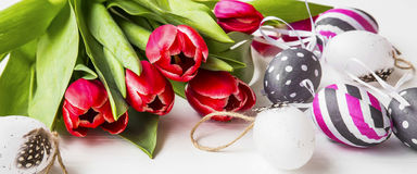 Spring tulips with decorated. Easter eggs. Spring tulips with decorated Easter eggs Royalty Free Stock Photos