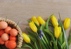 Spring tulips and Easter eggs lying on wood Royalty Free Stock Photography