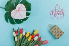 Spring tulips frame on background, top view. Postcard for Women`s Day. stock images