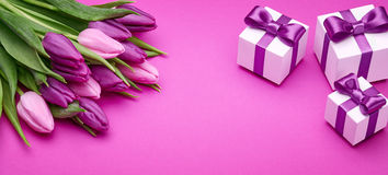 Spring tulips and gifts with satin bows Royalty Free Stock Photography