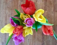 Spring Tulips. Pretty Spring tulips in a vase are yellow, pink, and, red and brighten the room royalty free stock photo