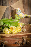 Spring tulips and textile bird Stock Photos