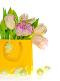 Spring tulips in yellow bag with easter eggs Royalty Free Stock Photo