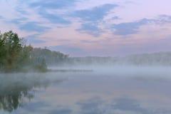 Spring Twilight Deep Lake. Foggy, spring shoreline of Deep Lake at dawn, Yankee Springs State Park, Michigan, USA royalty free stock photo