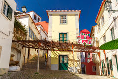 Spring typical Lisbon street, Portugal. The typical street in Alfama, the oldest district of the Old Town, Lisbon, Portugal stock photo