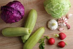 Spring vegetable set - whole heads of cabbage, zucchini, radish Royalty Free Stock Images