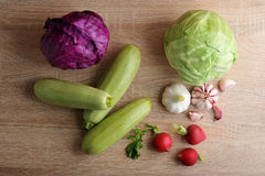 Spring vegetable set - whole heads of cabbage, zucchini, radish Stock Images
