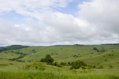 Spring view of agriculture fields in a mountain area. Near Bran city in Romania Stock Images