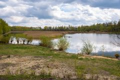 Borki lake on the border between Sosnowiec and Katowice cities. Spring view of the Borki lake on the border between Sosnowiec and Katowice cities, Poland Royalty Free Stock Images