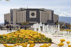 Spring view of flower garden in front of National Palace of Culture, Bulgaria. SOFIA, BULGARIA -APRIL 21, 2019: Spring view of flower garden in front of National stock photos