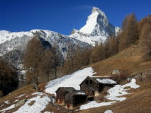 Spring view of Matterhorn rock. With wooden huts Stock Photos