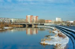 Spring view of the Miass River. University Embankment and parking of the shopping and entertainment complex Rodnik stock images
